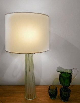 Baker green glass table lamp by Barbara Barry. Purchased in LA from the Baker showroom 4 years ago. 2- 60 watt bulbs max; each on pull chain. Original List $1200.- Modele's price: 595.-