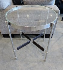 ** ITEM NOW SOLD** Round side table. (2 available) Purchased in 2015, never used. Chrome finish with glass top and leather details. Original List: $195.- each. Modele's Price: 115.- each.