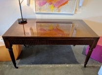 "**ITEM NOW SOLD** Milling Road writing desk. Glass top to protect surface. Brass casters. Full width drawer. Could also work as small dining table. 58.5""w x 32.25""d x 30.25""h. 950.-"