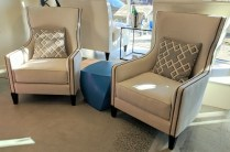 **ITEM NOW SOLD** Pair Oly 'Sienna' lounge chairs. Approx. 1 year old. Contrasting linen throw pillows included. Current list: $3825. each. Modele's Price: 1950.- pair