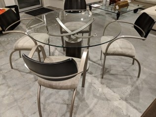 "CDG (Contemporary Design Group) dining set: glass top table is 48"" round, plus 4 arm chairs, 11 years old. Orig. List: $3.040. Modele's Price: 950.- set"