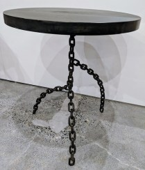 "**ITEM NOW SOLD** H.D. Buttercup side table with chain base. Approx. 2 yrs. old (scratches on metal top). 24.25""d. x 28.5""h. Orig. List: $675. Modele's Price: 295.-"