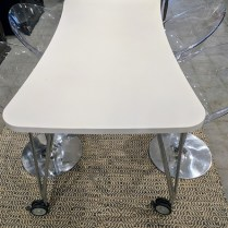 "Kartell 'Max' table for dining or desk. Laminated top is durable and easy to clean. Wheels with locks at base. TWO TABLES IN: Small: 63""l x 31.5""w. x 29""h. Current List: $1,345. Modele's Price: 450.- Medium: 74.75""l x 35.5""w x 29""h. Current List: $1,620. Modele's Price: 595.-"
