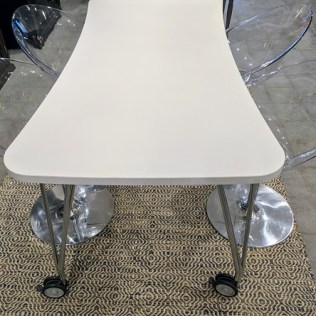"""Kartell 'Max' table for dining or desk. Laminated top is durable and easy to clean. Wheels with locks at base. TWO TABLES IN: Small: 63""""l x 31.5""""w. x 29""""h. Current List: $1,345. Modele's Price: 550.- Medium: 74.75""""l x 35.5""""w x 29""""h. Current List: $1,620. Modele's Price: 695.-"""