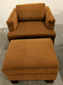 """**ITEM NOW SOLD** McKinnon 'Bradford' chair with ottoman, built locally in 2015. Solid walnut base, Robert Allen 'Novosuede' fabric. Solid hardwood frame. Chair: 34""""w x 35.5""""d x 30.5""""h. Orig. List: $3,510. Modele's Price: 850.-"""