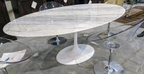 "**ITEM NOW SOLD** Reproduction Saarinen tulip dining table. Marble top on cast aluminum base. Just over one year old. 77.25""l x 48""w x 28.25""h. Current List: $2,274. Modele's Price: 1250.-"