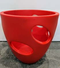 "**ITEM NOW SOLD** Serralunga pot with ""windows"" in red (2 available). Never used. 26""d. x 26""h. Orig. List: $335. each Modele's Price: 95. -each. REDUCED: NOW 95. FOR THE PAIR!"