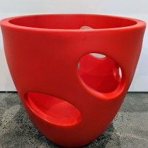 """**ITEM NOW SOLD** Serralunga pot with """"windows"""" in red (2 available). Never used. 26""""d. x 26""""h. Orig. List: $335. each Modele's Price: 95. -each. REDUCED: NOW 95. FOR THE PAIR!"""