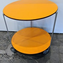 "**ITEM NOW SOLD** Zanotta small 'Giro' table with two shelves and wheels on base. Never used. 20"" dia. x 21""h. Orig. List: $920. Modele's Price: 450.-"