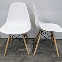 "**ITEM NOW SOLD** Set/4 Herman Miller Eames molded plastic side dining chairs with dowel base. Less than six months old, barely used. 18""w x 21""d x 31.5""h Current List: 495. per chair Modele's Price: 995. for set of four."