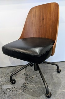 "**ITEM NOW SOLD** West Elm desk chair, approx. 4-5 years old. Leather seat, curved wood back, casters, adjustable seat height. 20""w x 22""d x 35.5"" Current List: $449. Modele's Price: 225.-"