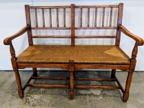 """**ITEM NOW SOLD** Bausman 2-seater bench, style #3276. Purchased in 1999. Woven rush seat, distressed finish. 44.25""""w x 22.5""""d x 36.5""""h. Orig. List: $2,000.-3,000. Modele's Price: 950.-"""