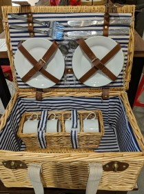 "**iTEM NOW SOLD** Wicker picnic basket; includes 4 each: plate/mug/knife/fork/ spoon. Used once. 18""w x 12""d x 9.25""h. 95.-"
