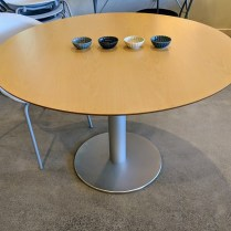 "**ITEM NOW SOLD** Stua (Spain) 'Zero' pedestal dining table. Stored in original boxes, never used in a home. Beechwood top on aluminum base. 43.5""dia. x 28.25""h. Current List: $1,495. Modele's Price: 595.-"