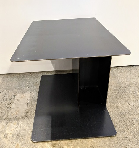 "Living Divani (Italian) steel side table. Approx. 12 years old, nice patina. 23.5"" x 15.25"" x 16""h. Orig. List: $1,200. Modele's Price: 595."