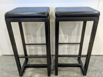 "Pair Zeus bar-height stools. Black leather seat on steel base. 16.5"" x 14.25"" x 32.5""h. Current List: $499. Each. Modele's Price: 395. Pair"