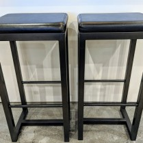 "**ITEM NOW SOLD** Pair Zeus bar-height stools. Black leather seat on steel base. 16.5"" x 14.25"" x 32.5""h. Current List: $499. Each. Modele's Price: 395. Pair"