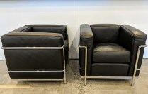 "Pair Cassina LC2 ""Cube"" chairs. Designed by Le Corbusier. Chromed steel frame with black leather. 30""w x 27""d x 26""h. Current List: $5,055. each plus $279. freight. Modele's Price: 4950.- pair"