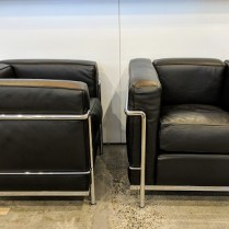"**ITEM NOW SOLD** Pair Cassina LC2 ""Cube"" chairs. Designed by Le Corbusier. Chromed steel frame with black leather. 30""w x 27""d x 26""h. Current List: $10,520. pair, plus $279. freight. Modele's Price: 4250.- pair"