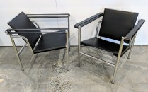 "Pair modern black leather and chromed framed chairs. Purchased from Room & Board 3 years ago (discontinued style). 23.25""w x 25""d x 26.25""h. Orig. List: $375. each Modele's Price: 450.- pair"