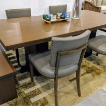 """**ITEM NOW SOLD** Custom dining set, designed by Holly McKinley. Table separates into two smaller tables. Includes 4 custom chairs in leather and 2 benches. Table: 84""""l x 39""""w x 30""""h. Orig. List: $21,562. set. Modele's Price: 3500.- set"""