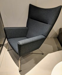 """Hans Wegner Wing chair (CH445) by Carl Hansen Co. (2 available). Less than 10 years old, very little use. Felted Danish wool. 35""""w x 36""""d x 41""""h. Current List: $6,935. Modele's Price: 3475.- each, or 6,255. for a pair."""