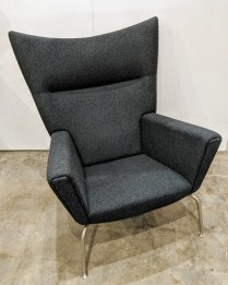 "Carl Hansen CH445 Wing chair, designed by Hans Wegner in 1960. Less than 10 years old, in like-new condition. Felted Danish wool upholstery. 35""w x 36""d x 41""h. Current List: $6,935. each. Modele's Price: 2950. each (two available)."
