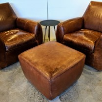 "**ITEM NOW SOLD** Pair Dakota Jackson 'Ke-Zu' club chairs in distressed leather, with custom ottoman. Aprrox. 10 years old. 34.5""w x 35""d x 33.5""h. 2950.- set/3 pcs."