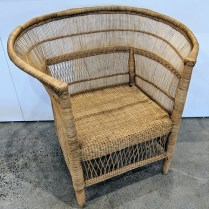 """**ITEM NOW SOLD** Woven rattan armchair from Africa. Purchased from Nickey Kehoe, Los Angeles. 32.5""""w x 22.5""""d x 33""""h. Orig. List: $690. Modele's Price: 225.-"""