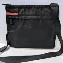 **ITEM NOW SOLD** Prada Sport messenger bag in black nylon. Adjustable shoulder strap. Orig. Price: $350.-395. Modele's Price: 175.-