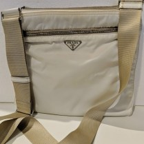 **ITEM NOW SOLD** Prada nylon cross body messenger bag with adjustable strap. 150.-