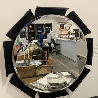 "Round mirror with petal frame, from Lucca in Los Angeles. 29"" dia. Orig. List: $1250. Modele's Price: 595.-"