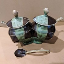 "Sam Chung ceramic double condiment server. Includes three ceramic spoons. 8""w x 4.5""d x 6.25""h 80.-"