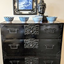 """**ITEM NOW SOLD** 2-Piece Antique Japanese tansu with black lacquer finish. Late 19th century. 33.5""""w x 16.25""""d x 39.5""""h. Orig. List: $1,400. Modele's Price: 650.-"""