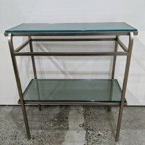 """**ITEM NOW SOLD** Steel/glass two-tier table, designed by Steven Hensel of Studio Steel (no longer in production), c. 1994-96. 26""""w x 13""""d x 29""""h. Orig. List: $1,075. Modele's Price: 550.-"""