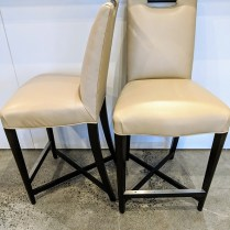 Donghia 'Studio X' counter height stools. Four total, sold as pairs. Ebonized maple/Great Plains faux leather. Orig. List: $4,009. per pair. Modele's Price: 1950. per pair