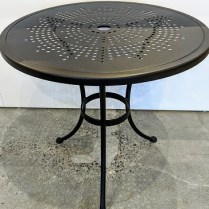 """**ITEM NOW SOLD** O.W. Lee outdoor dining table. 30"""" dia. x 29.25""""h. 125.-"""