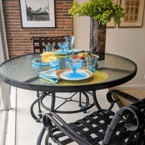 """**ITEM NOW SOLD** Woodard 'Ramsgate' outdoor dining set. 47"""" round table with four armchairs. 650. set"""