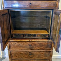 Interior of antique cabinet. Rail for hanging silverware, or use for bottle storage.