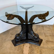 "**ITEM NOW SOLD** Dolphin center table in bronze. Age/maker not known. Thick glass top with beveled edge. 45"" dia. x 30.75""h. 1500.-"
