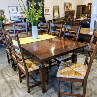 South Cone Trading Co. dining set; table with two self-storing leaves and 10 dining chairs. Purchased from Miller Pollard in 2002. 2750.- set