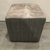 "**ITEM NOW SOLD** Custom ottoman, 6 yrs. old. Cowhide top, fabric sides. 20"" sq. x 20.5""h. Orig. List: $450. Modele's Price: 195.-"