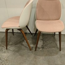 "Pair Gubi (Danish co.) 'Beetle' dining chairs, designed by GamFratesi, made in Italy. Discontinued in this finish combination. 19""w x 22""d x 34""h. Orig. list: approx. $1600. pair Modele's Price: 750.- pair"
