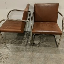 """Pair vintage Brueton tubular steel dining arm chairs. Polished stainless steel, leather upholstery. Made in USA. 22""""w x 24""""d x 31.25""""h. 650. pair"""