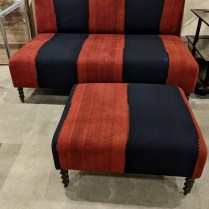 "Custom settee with matching ottoman, upholstered in vintage kilim textile. Made in Los Angeles in 2010. Two red back pillows included. Settee: 60.5""w x 35.75""d x 35.75""h. Ottoman: 31""w x 25""d x 15.5""h. Orig. list: $6,000. Modele's Price: 2475. set"