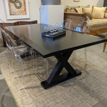 """Noir Industries 'X' dining table made of Asian mahogany with rubbed black finish. 84.5""""l x 44""""w x 30.5""""h. Current list: $2,548. Modele's Price: 650."""