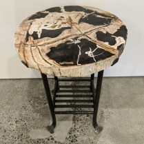 """**ITEM NOW SOLD** Petrified wood side table on forged iron base. Purchased at DFG showroom in the Seattle Design Center in 2016. 18"""" dia. x 24""""h. Orig. list: $1,350. Modele's Price: 650."""