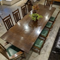 """**ITEM NOW SOLD** Stickley dining set, purchased in 2001 from Masins, all solid oak. 'Keyhole Trestle' table with two extensions and 10 dining chairs. Two armchairs have inlay of ebonized hardwood, cherry and holly and 8 side chairs with no inlay. Leather seats. Table: 90""""l x 42""""w x 30.25""""h. With extensions: 120""""l max. Current list: $20,047. Modele's Price: 7500."""
