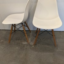 """**ITEM NOW SOLD** Set/6 Herman Miller Eames plastic molded side dining chairs. Purchased in 2015. Dowel legs (walnut) with black metal. 18""""w x 17.75""""d x 32""""h. Current list: $3,570. set/6. Modele's Price: 1750. set/6"""