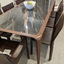 """Roche Bobois 'Brio' dining table, 5-7 years old. Walnut frame with ceramic top in faux 'noir desir' marble. 78.25""""l x 39""""w x 29.5""""h. Current list: $6,600. Modele's Price: 2750."""